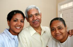an elderly couple and their companion